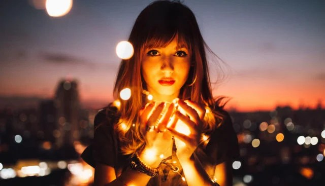 Woman with lights in her hands - a symbol of sexual empowerment