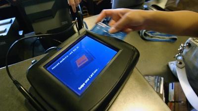 Credit-card-is-swiped-jpg_20150403035801-159532