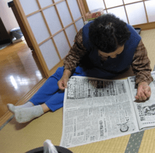 Grandma, 82, reading the paper