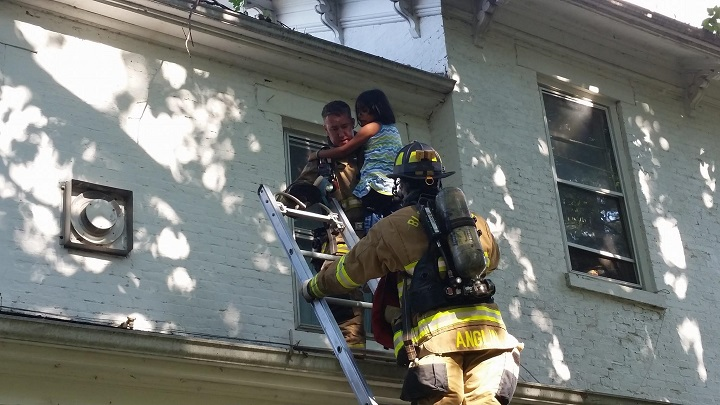 Firefighters rescue girl from second floor during fire