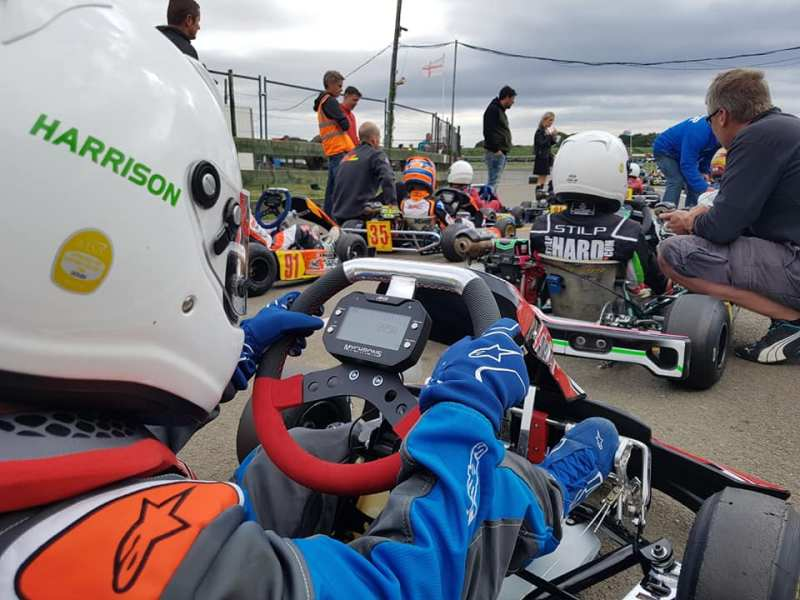 Close up behind the wheel of Harrisons Kart