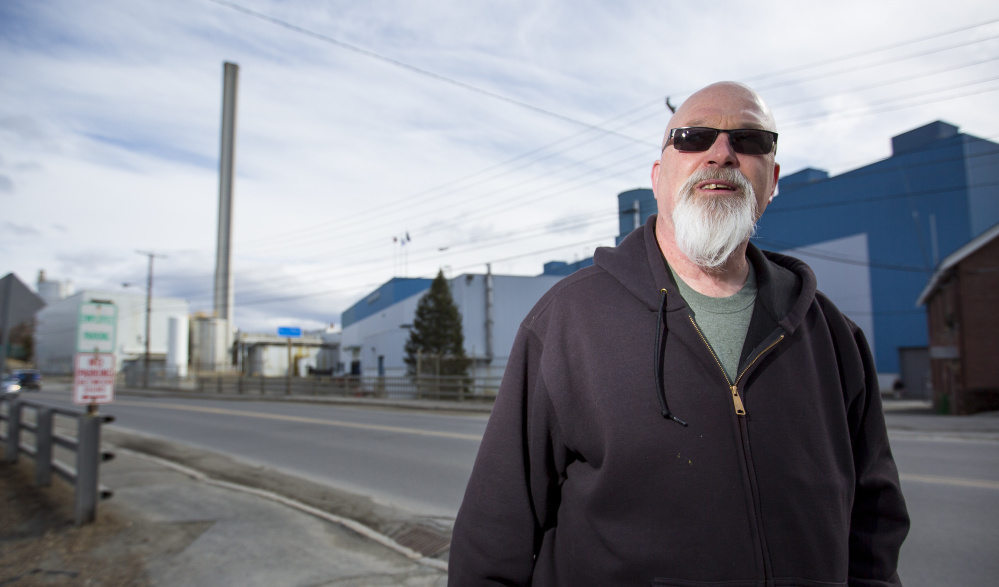"""""""I guess I'll just ride this to the bottom,"""" says millworker Robert Lake, 57, of Skowhegan. He is among more than 200 people who will lose their jobs when Madison Paper Industries closes in May."""