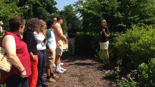 Professor of Biology Anne Lubbers (right) gives a tour of the Native Plant Garden during the 2015 Sustainability Workshop