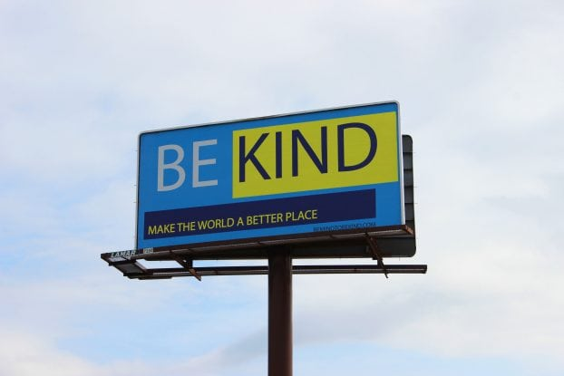 "Centre professor David Anderson places a ""Be Kind"" billboard on Highway 127 in Frankfort to help remind people to be kind in the midst of the problems going on in the nation."