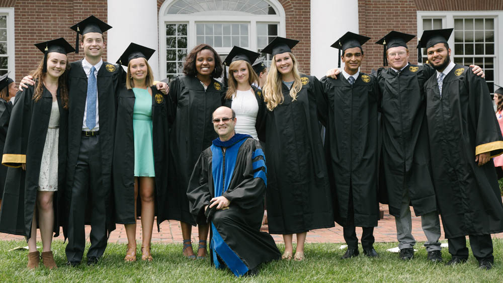 Dr. Joe Workman poses with 2017 graduates accepted into medical school