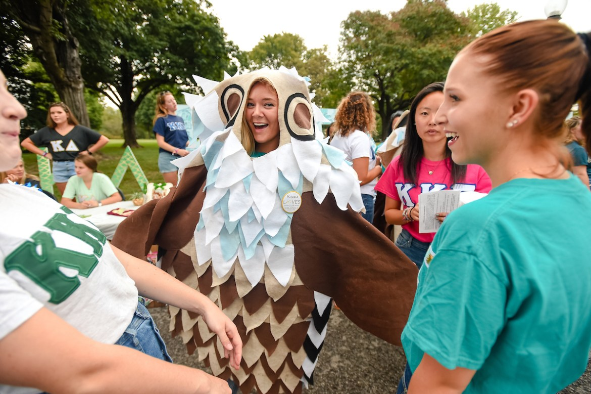 female student dressed as an owl at the activities Expo
