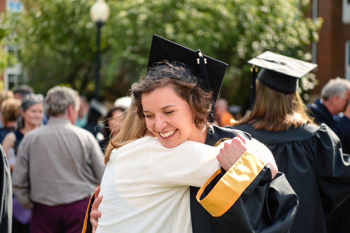 Madison Stuart '17 receives a hug after Commencement