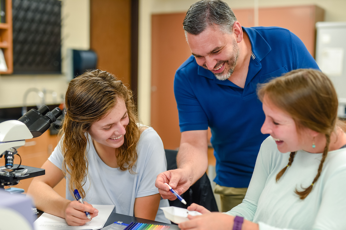 Professor Klooster works with students in a lab