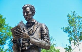 Lincoln statue in front of Crounse Hall
