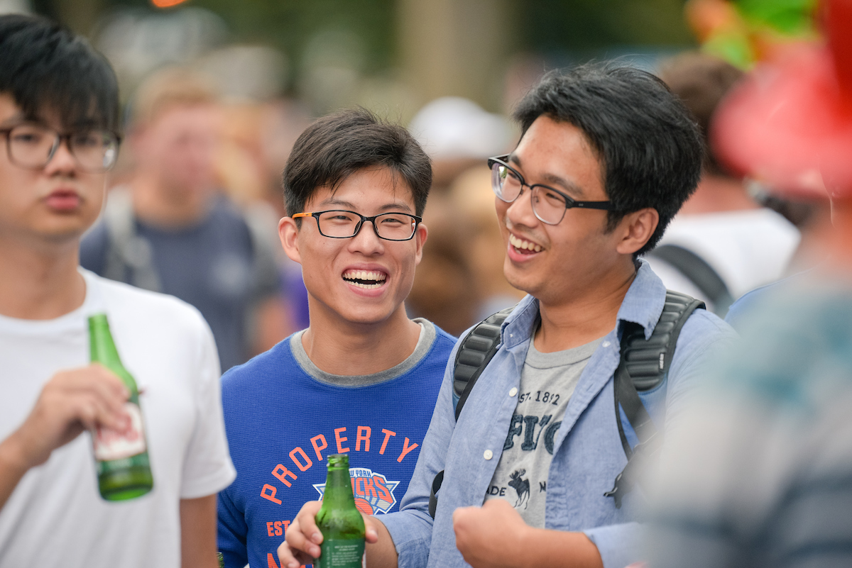 Male Asian students enjoy Activities Expo
