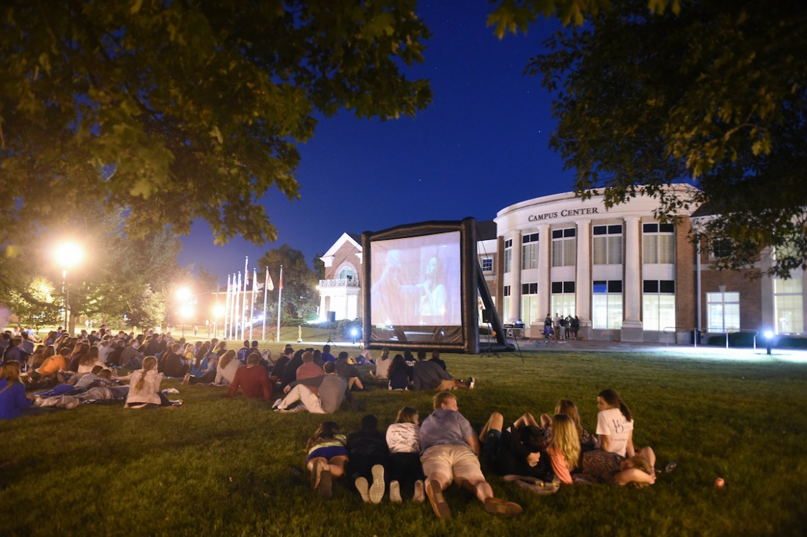 students enjoying a movie on the Campus Center lawn