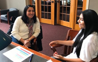 "A student speaks with a human ""book"" in Grace Dougherty Library"