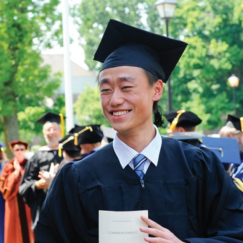 Jerry Yang '12 outside at Commencement