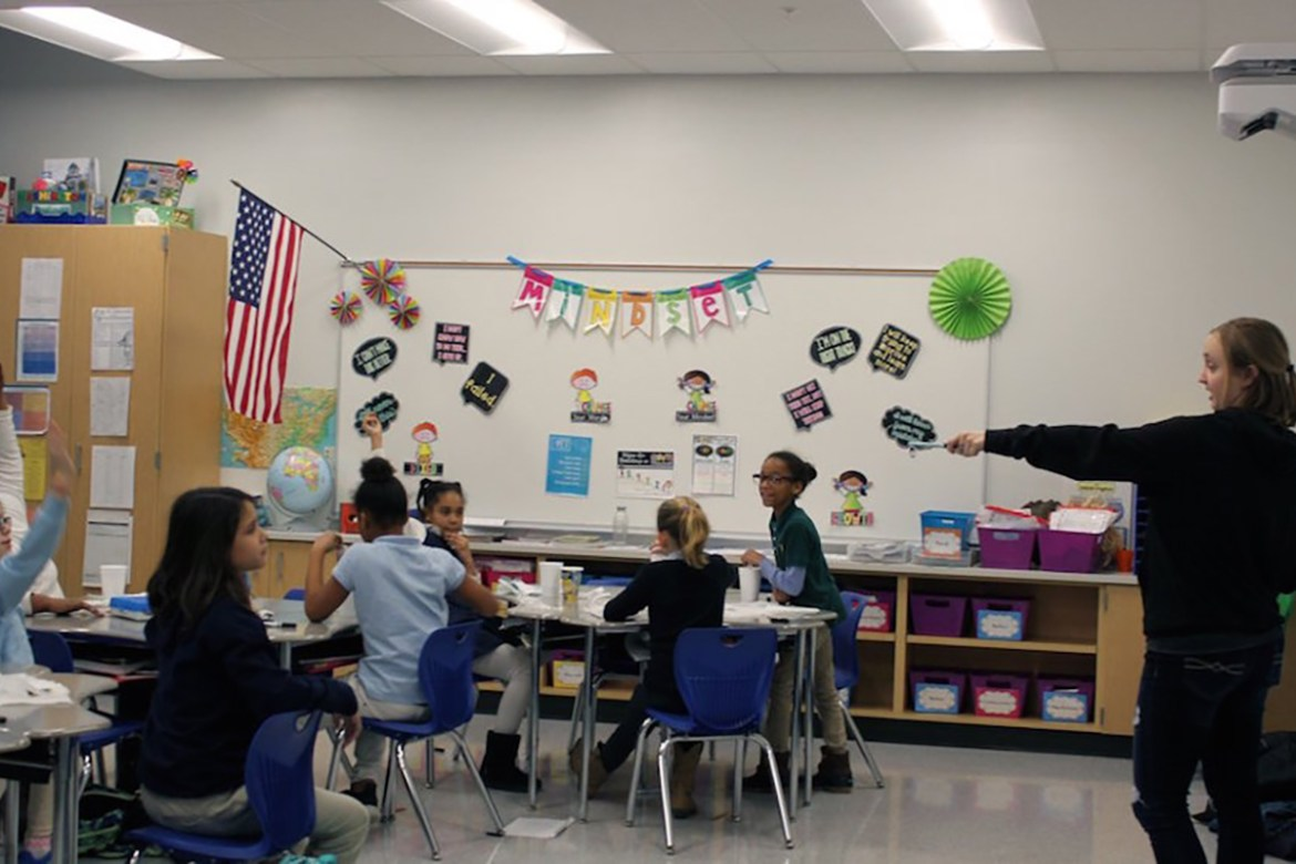 Centre College studentKatie Malone '19 leads a GEMS session at Toliver Elementary. Photo courtesy of Danville Schools