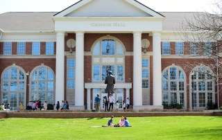 Students enjoy a spring day outside Crounse Hall