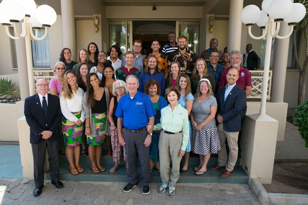 Katy Cremer '14 and other Peace Corps volunteers gather with Former President George W. Bush and Mrs. Laura Bush
