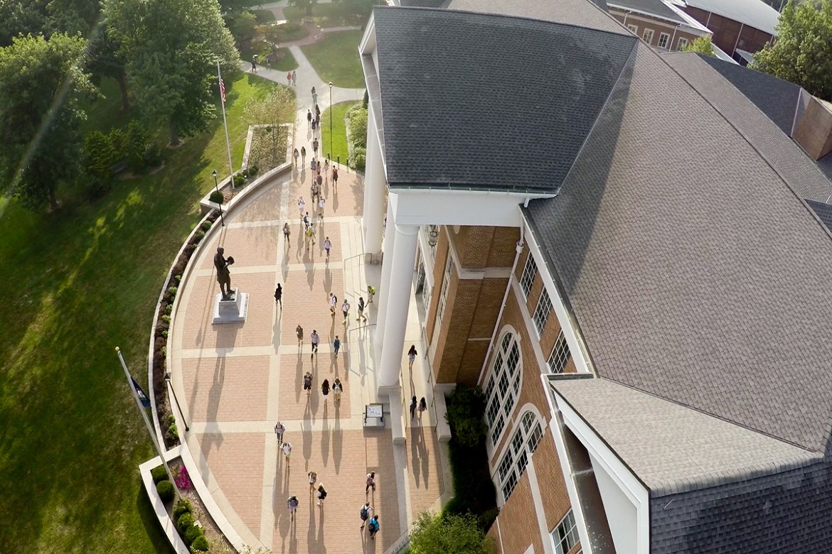 Students walk around campus during the first day of class on August 31, 2015.