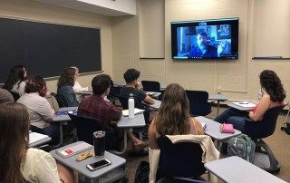 Photo of students skyping with author, Brian Turner in Professor Stacey Peebles spring course titled 'War Stories'