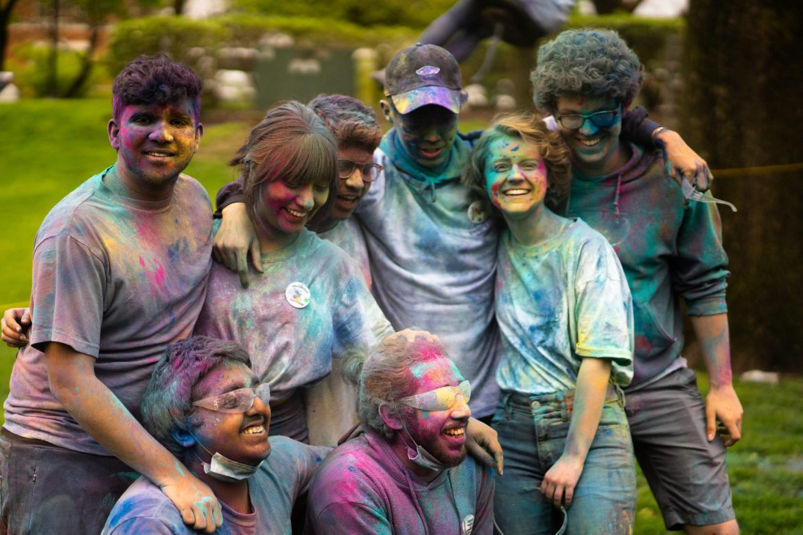 Students and faculty take part in a celebration of Holi durning the color your professor/color fest.