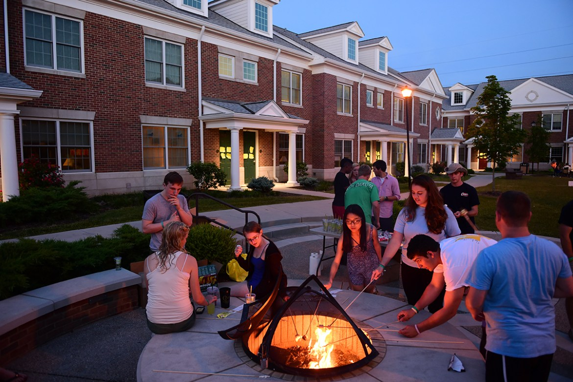 Graduating Seniors Making S'mores with the Roush's by the Brockman Commons Firepit 2014