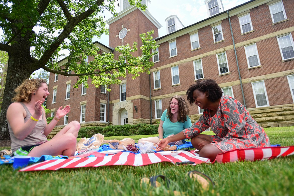 Kristen Means '15 (left) Rachel Kinnison '15 (middle) and Vestine Muhoza '15 enjoy a picnic on Breck beach on May 23, 2015 during commencement weekend