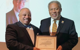 At left, Kevin Russell, vice chair of Kentucky's Martin Luther King Jr. State Commission presents J.H. Atkins the MLK Jr. Leadership Award Wednesday night in Frankfort (Photo submitted)