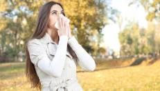 young woman have flu, autumn park