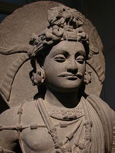 Bodhisattva. Monastero di Shahbaz-Garhi, arte del Gandhara, I-III secolo. Museo Guimet, Parigi.