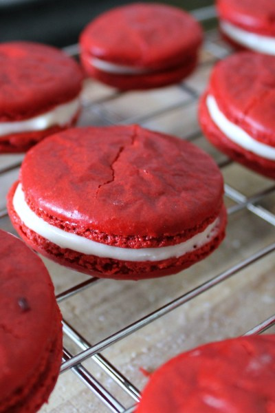 Red Velvet Macarons - A classic french cookie made with a red velvet cookie and cream cheese filling. A elegant little dessert perfect for bridal showers and tea parties!