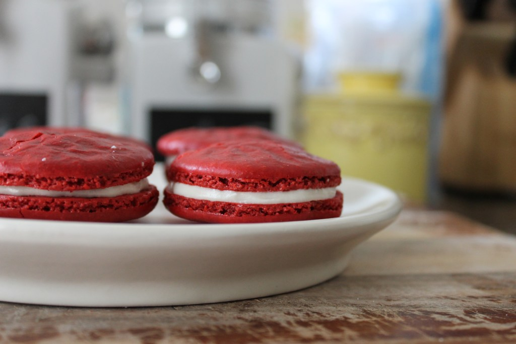 Four Red Velvet Macarons on a plate