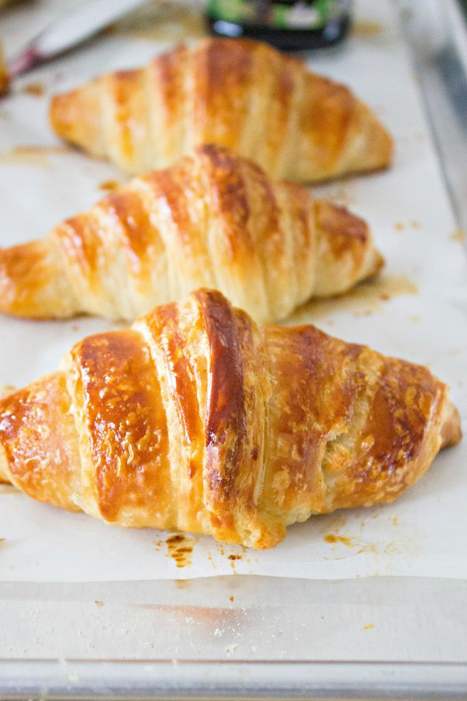 Classic Butter Croissants on a baking sheet with parchment paper
