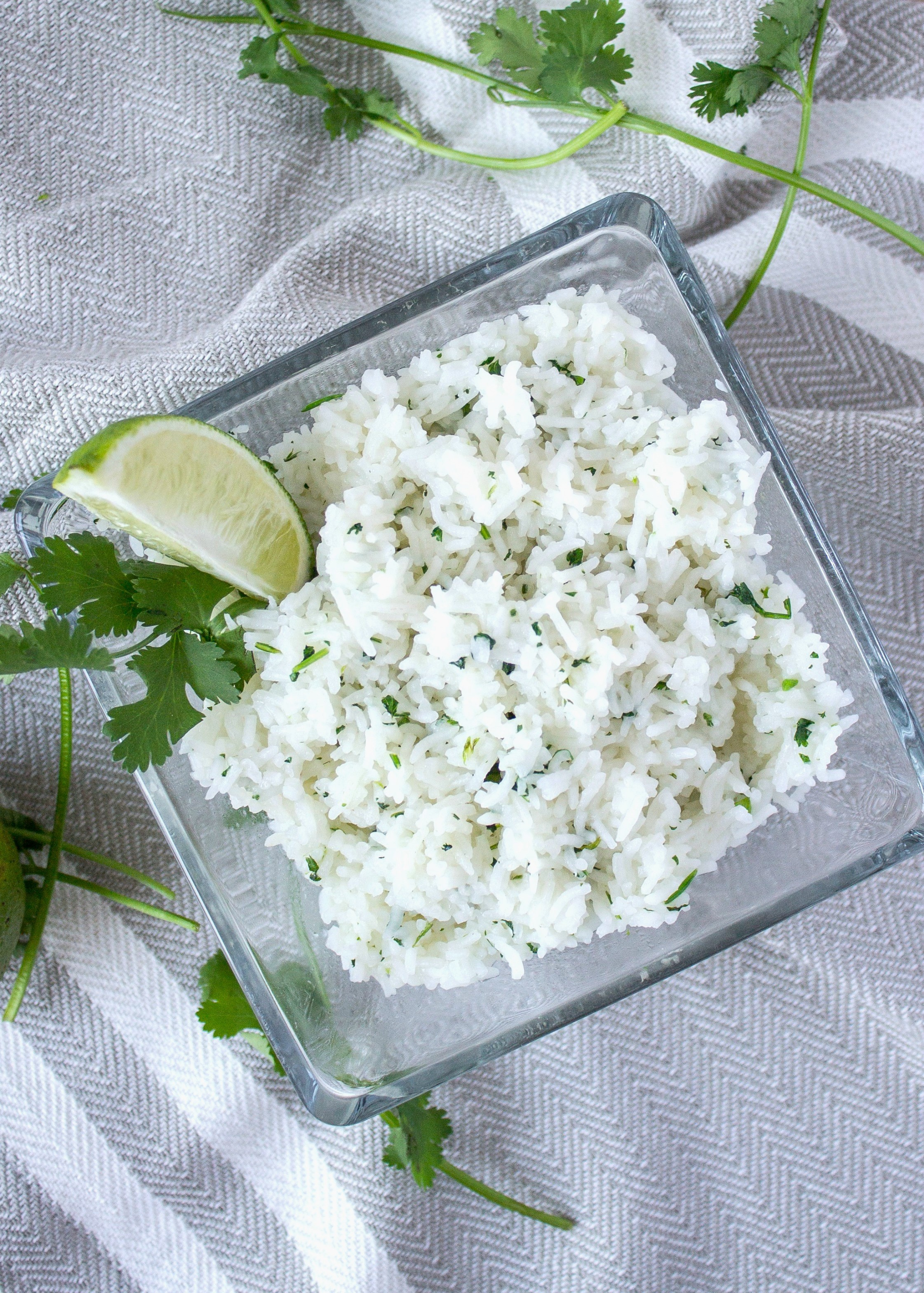 Cilantro lime rice with a lime wedge