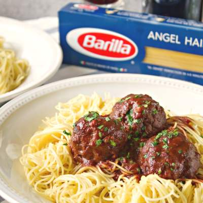 Drunken Spaghetti Meatball - A childhood favorite, with an adult twist. These meatballs are soaked in a rich, red wine gravy and pairs perfectly with Barilla Angel Hair pasta.