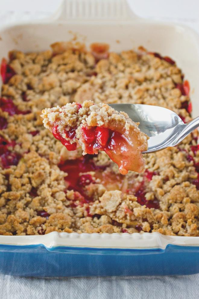 Cranberry Apple Crumble - A warm dessert made with seasonal flavors of cranberry and apple and topped with crunchy brown sugar crumbles. The only thing that can make this dessert even better is a generous scoop of vanilla ice cream!