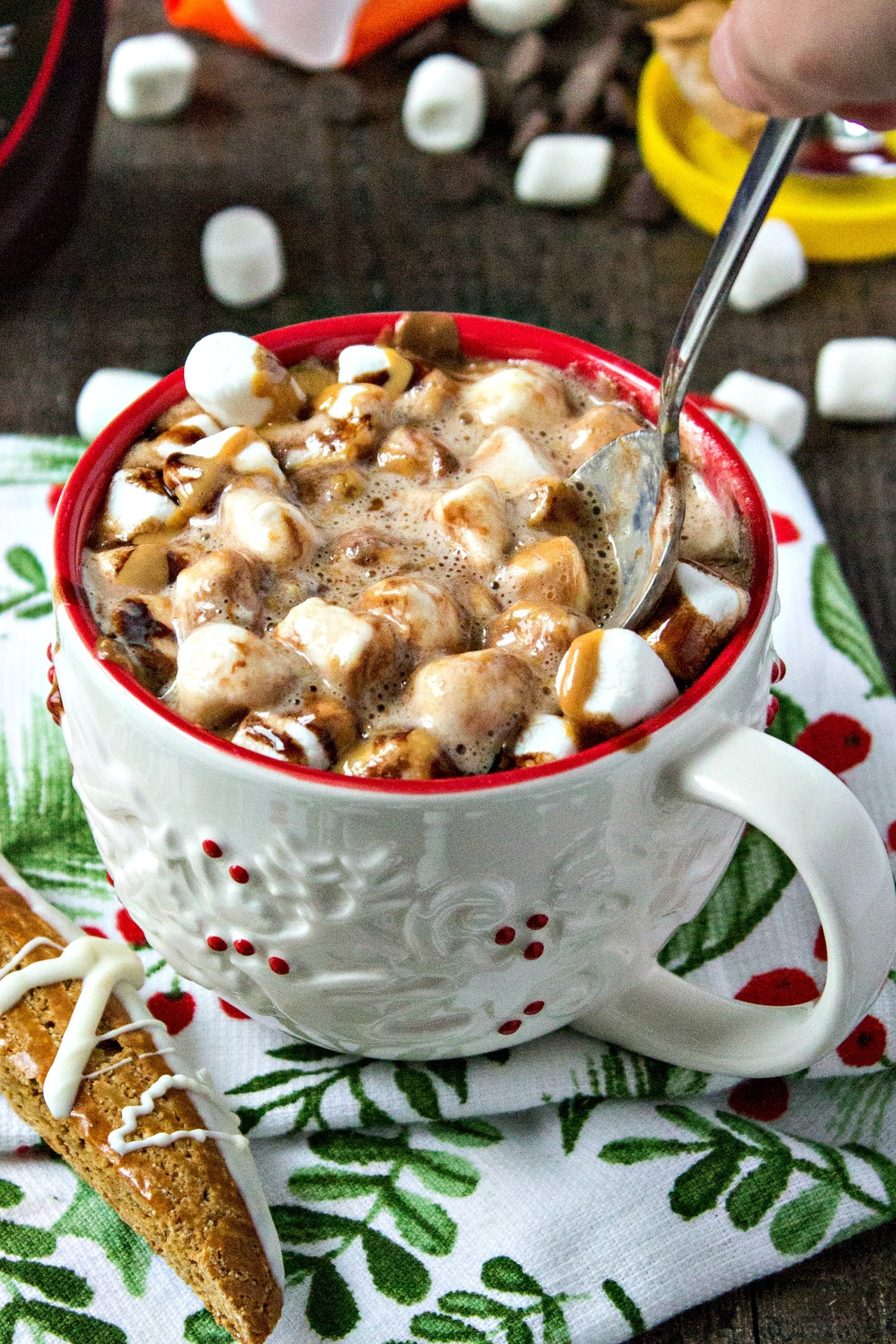 Cup of Peanut butter hot chocolate topped with chocolate syrup, marshmallows and peanut butter