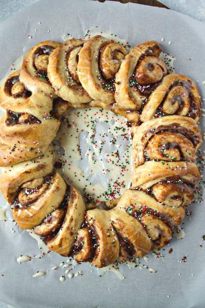 Cinnamon Roll Wreath - A fun, new way to serve a plate of cinnamon rolls for breakfast or brunch. Your guests will go crazy for the presentation, as well as the taste of these cinnamon rolls!
