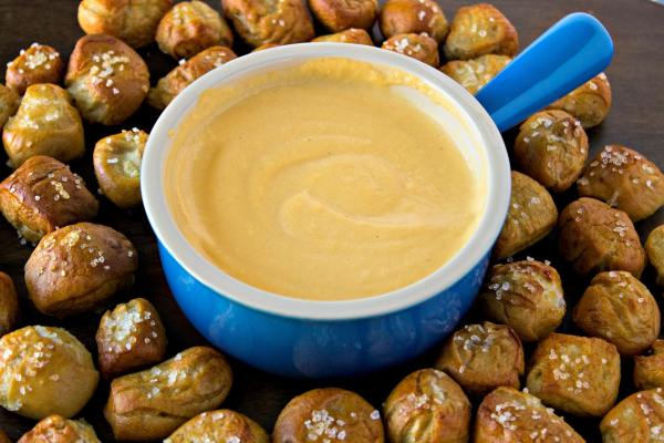 Pretzel Bites and Beer Cheese Dip - The perfect snack for your party and tailgate needs. You won't be able to resist these soft & chewy pretzel bites and creamy beer cheese dip.