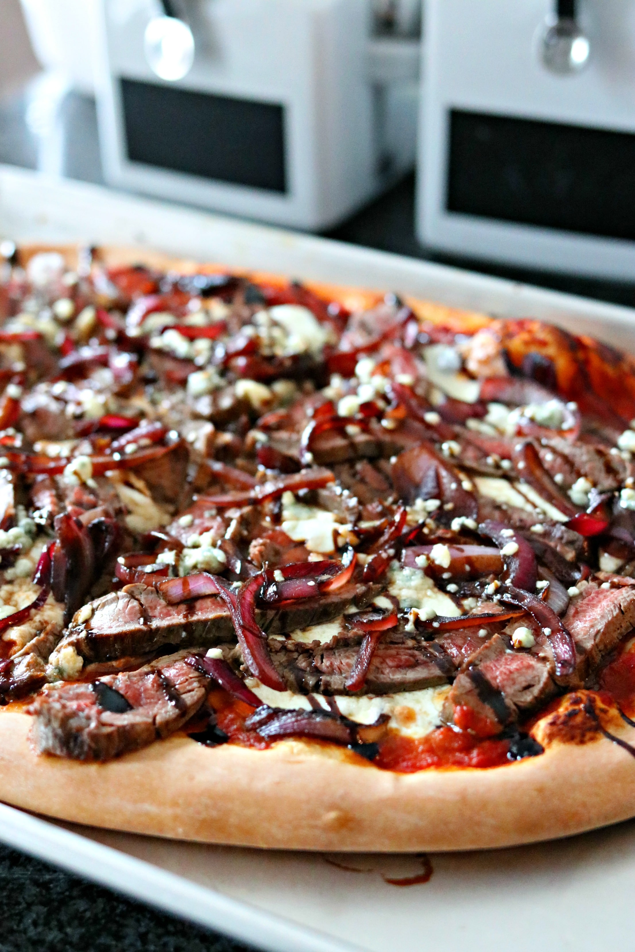 Steak & Blue Cheese Pizza on a plate