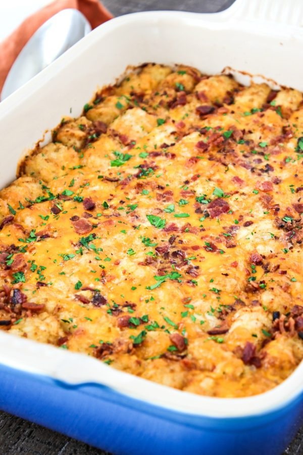 Cheesy Tater Tot Breakfast Casserole - A breakfast casserole that incorporates all of your favorite breakfast foods - eggs, bacon, sausage, cheese, and potatoes. This is sure to satisfy the whole family!