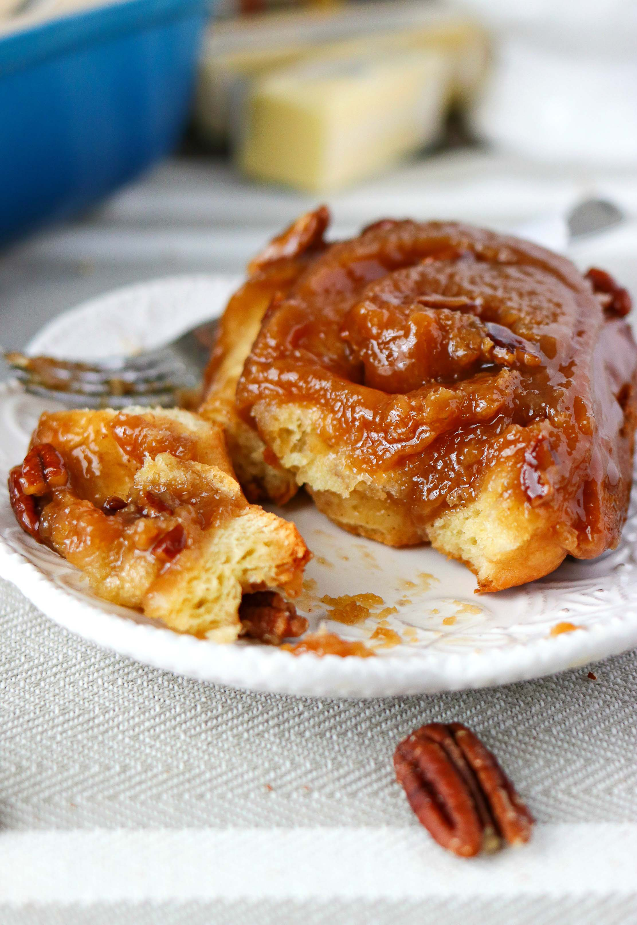 Pecan Sticky Buns - A super ooey, gooey, sticky bun made with brioche dough and tons of brown sugar and crunchy pecans. The flavor and texture of these buns will blow you away!