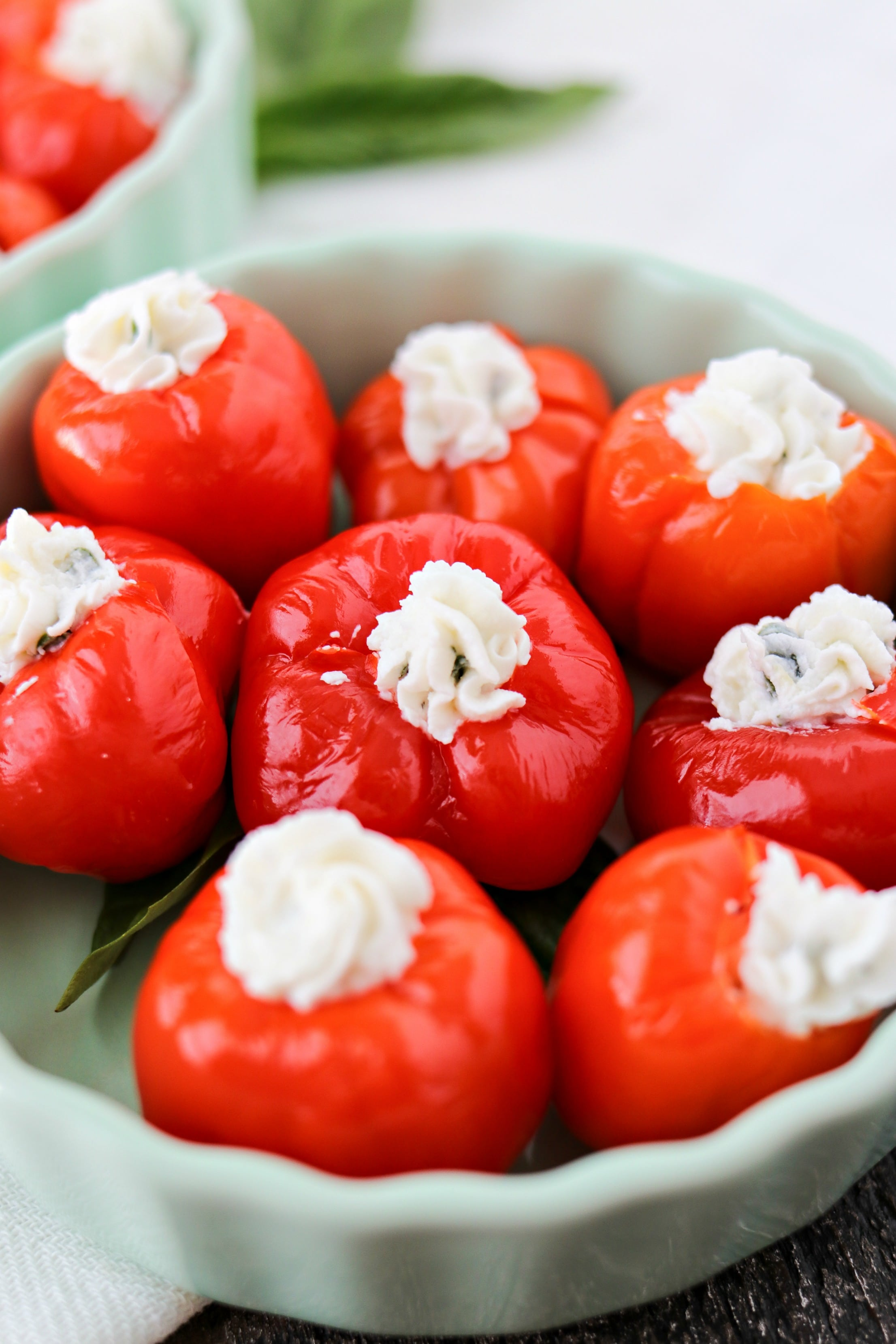 Red small peppers stuffed with goat cheese