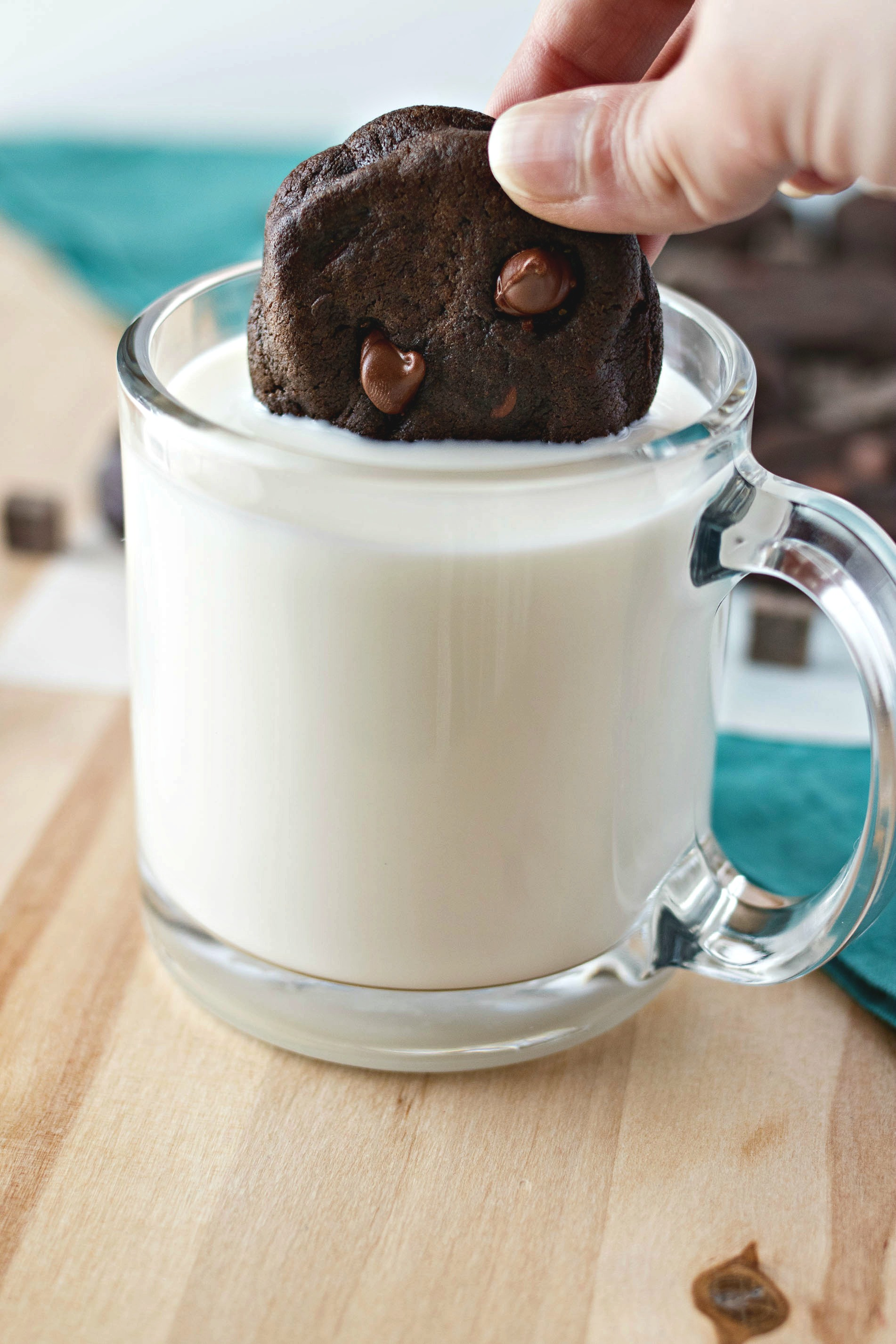 Dunking a Triple Chocolate Soft Baked Cookie in milk