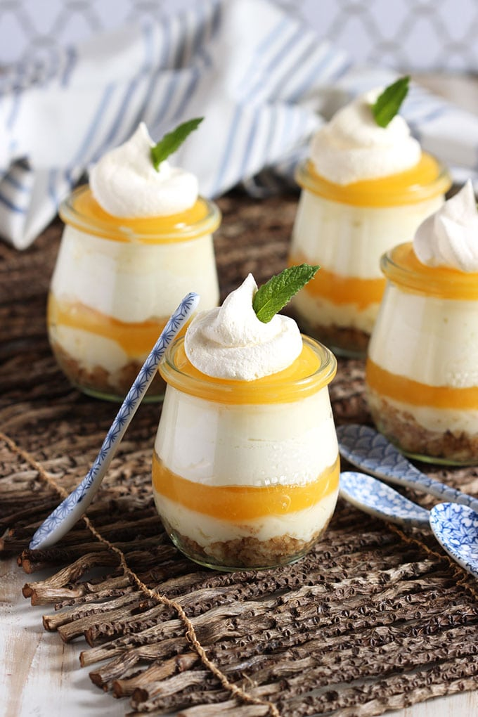 Four dishes of Lemon Meringue Cheesecake Parfaits