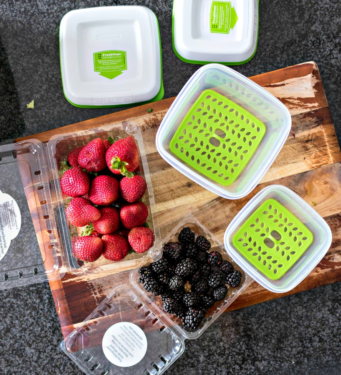 Open containers of strawberries and blackberries next to freshworks produce savers