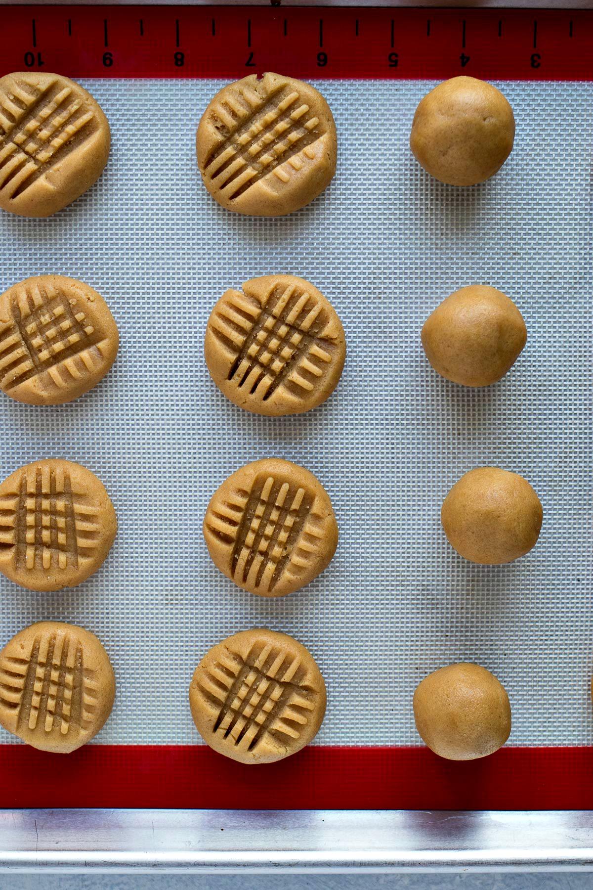 Flattened peanutbutter cookie dough next to dough balls