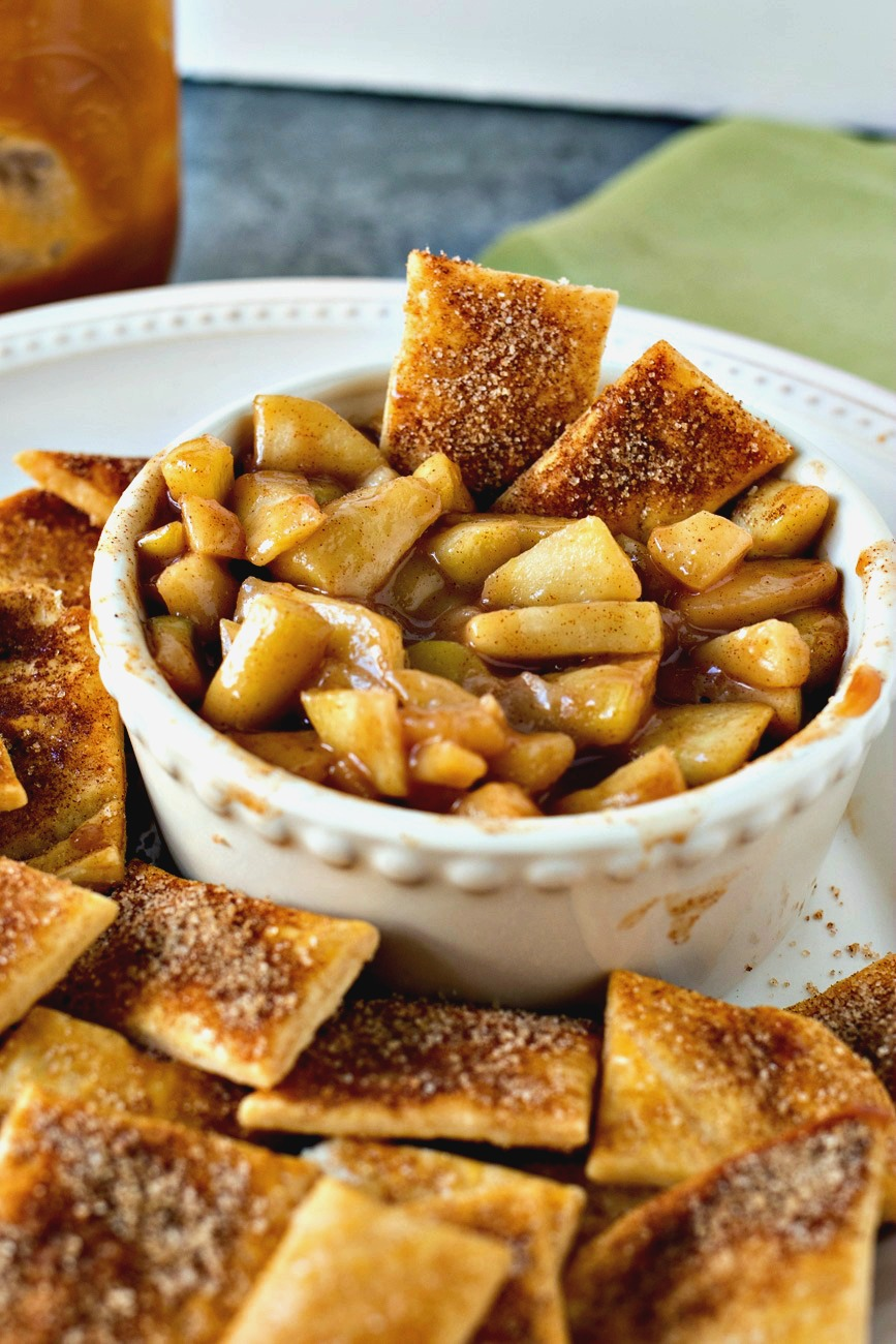 Salted Caramel Apple Pie Dip with Pie Crust Chips - Decadent homemade apple pie filling is combined with gooey salted caramel sauce and served with crispy cinnamon sugar pie crust chips