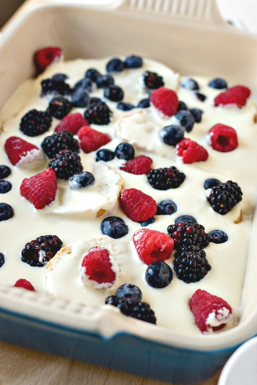 Berries added on top of the cream cheese filling layer