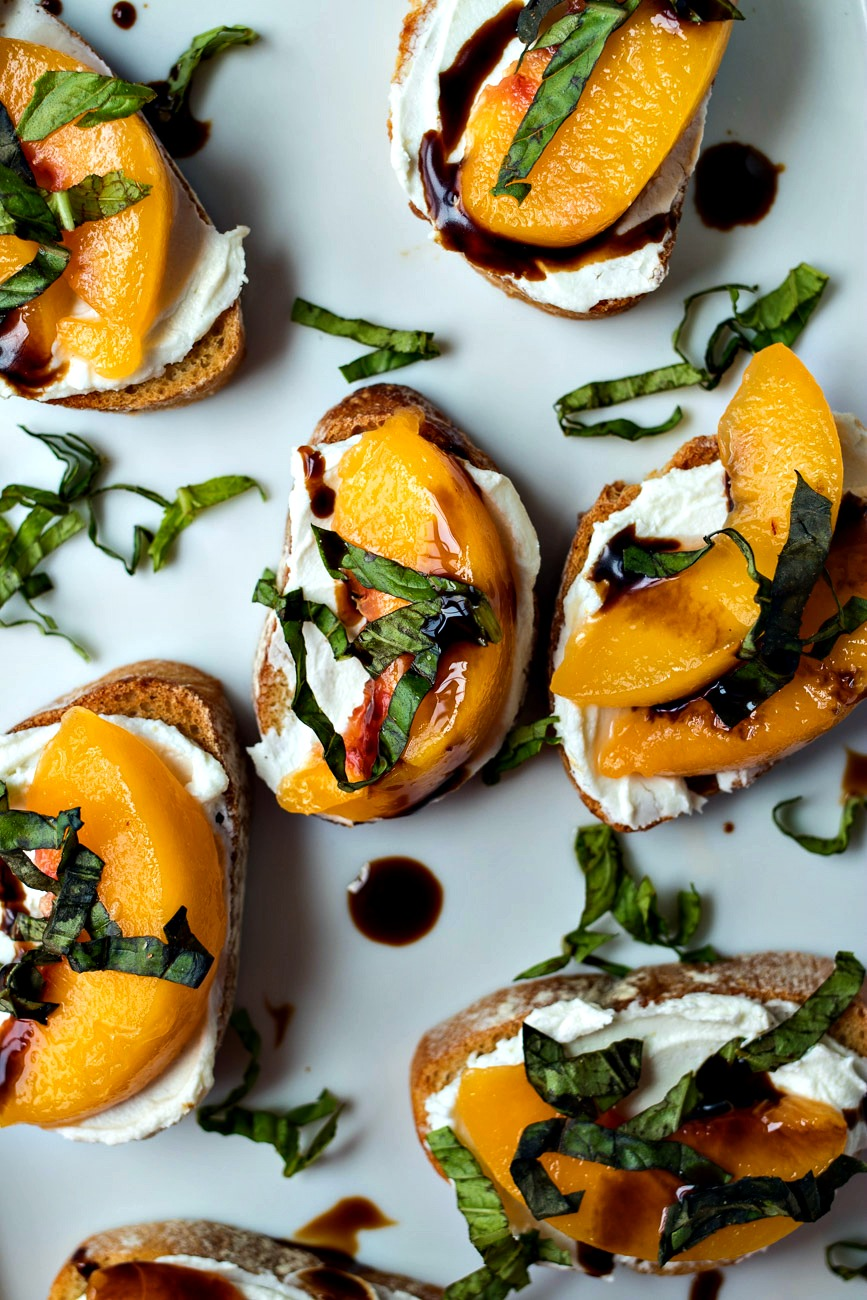 Peach & Goat Cheese Crostini with whole peach slices on top