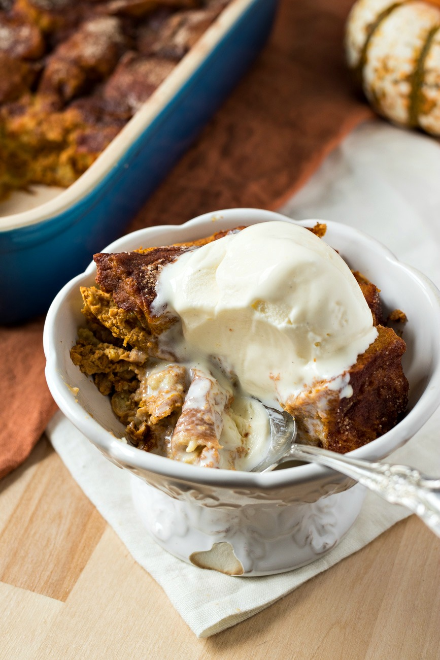 Bowl of Pumpkin Snickerdoodle Bread Pudding with ice cream melted over the top