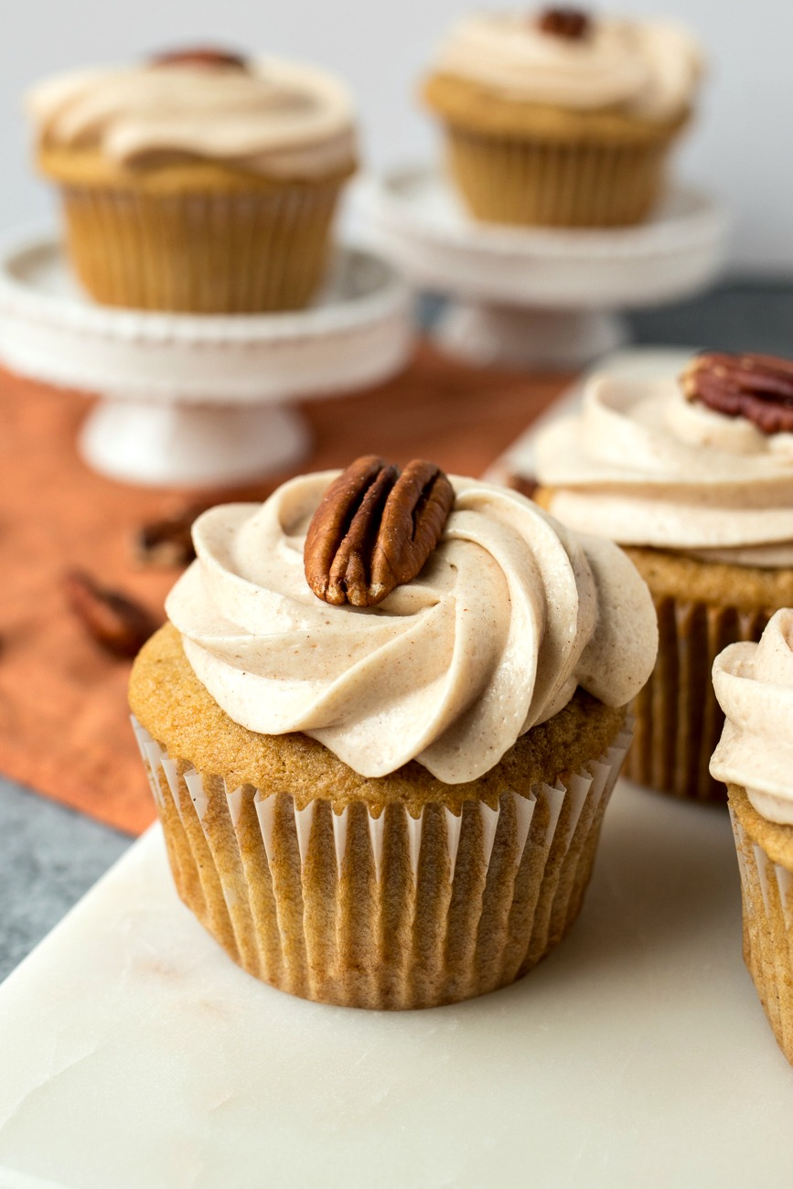 Sweet Potato Cupcakes with Cinnamon Cream Cheese Frosting - Super moist and perfectly spiced sweet potato cupcakes are topped with the creamiest cinnamon cream cheese frosting. Move over, pumpkin - there's a new spiced cupcake in town!